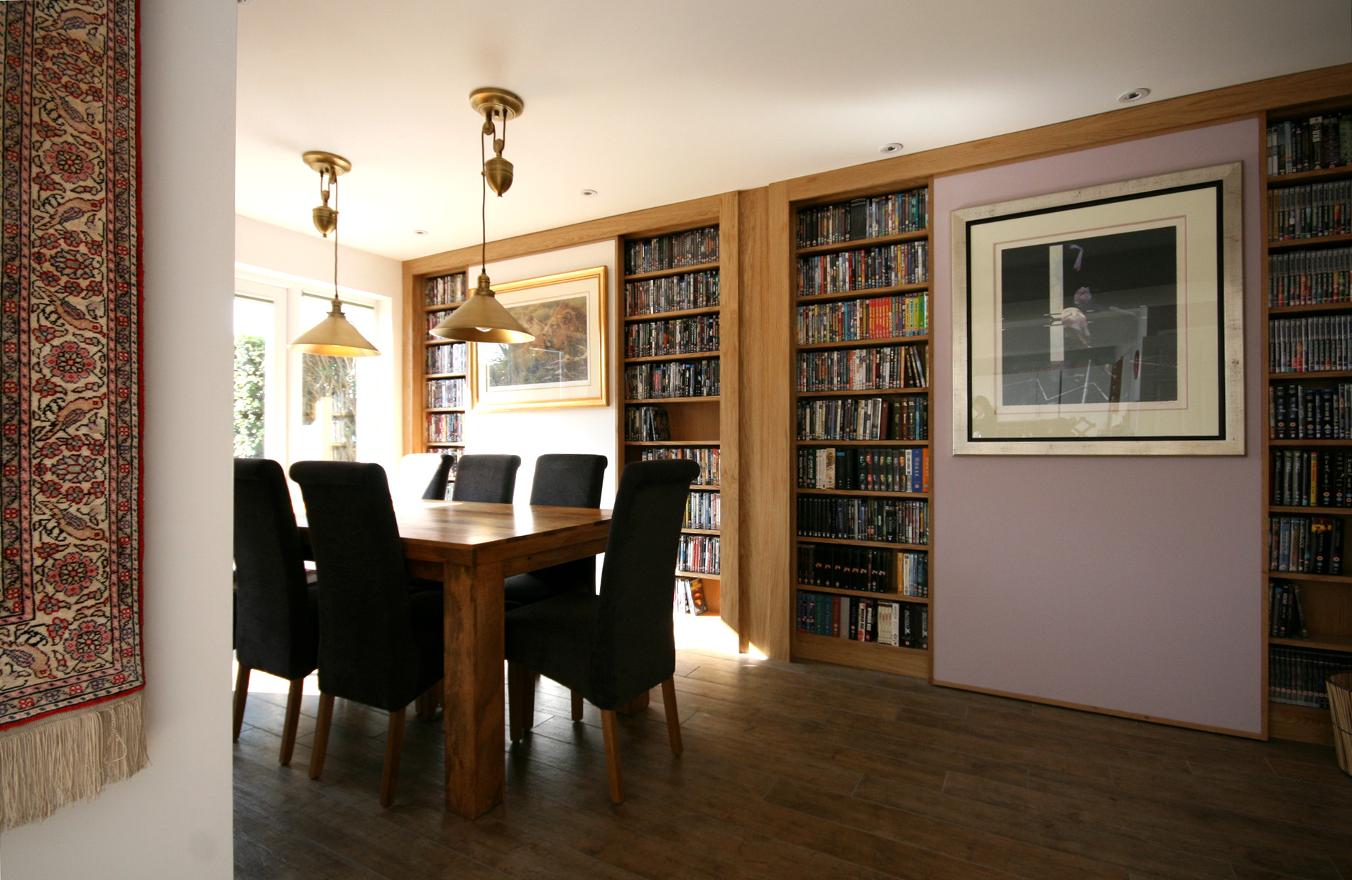 Built in book cases with sliding screens