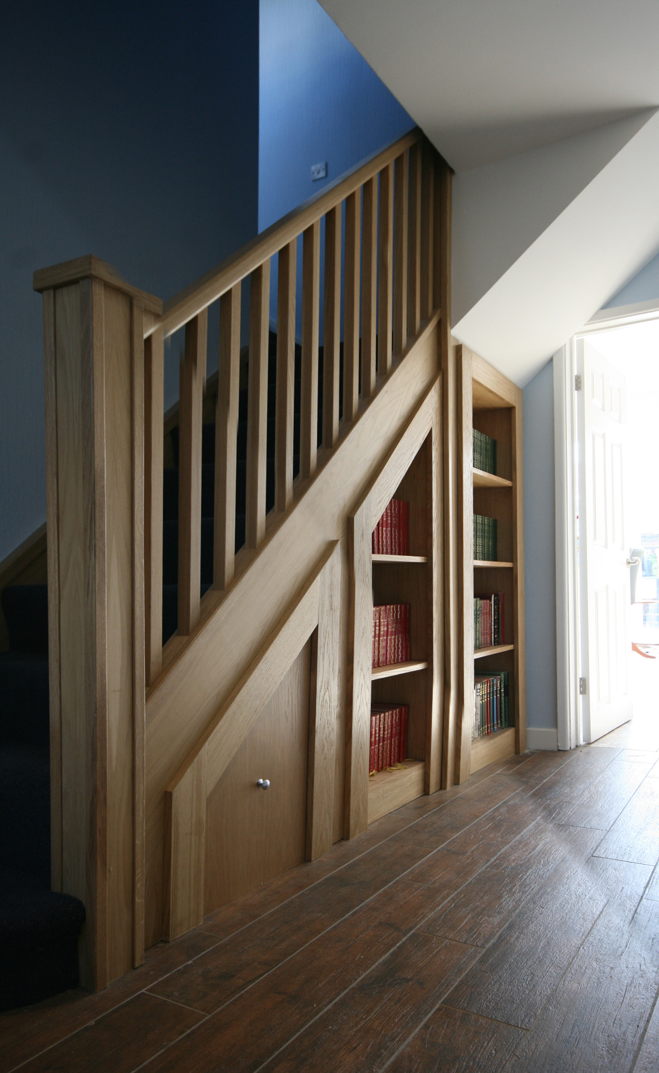 Built in shelves under stair