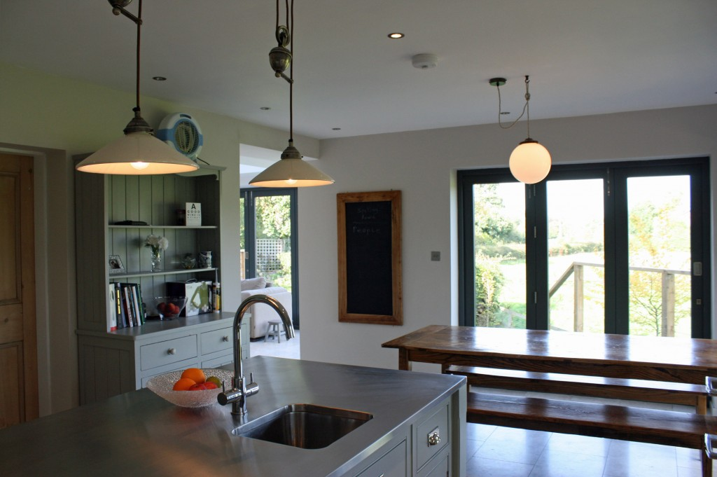 Kitchen with stainless steel counter and wooden dining table