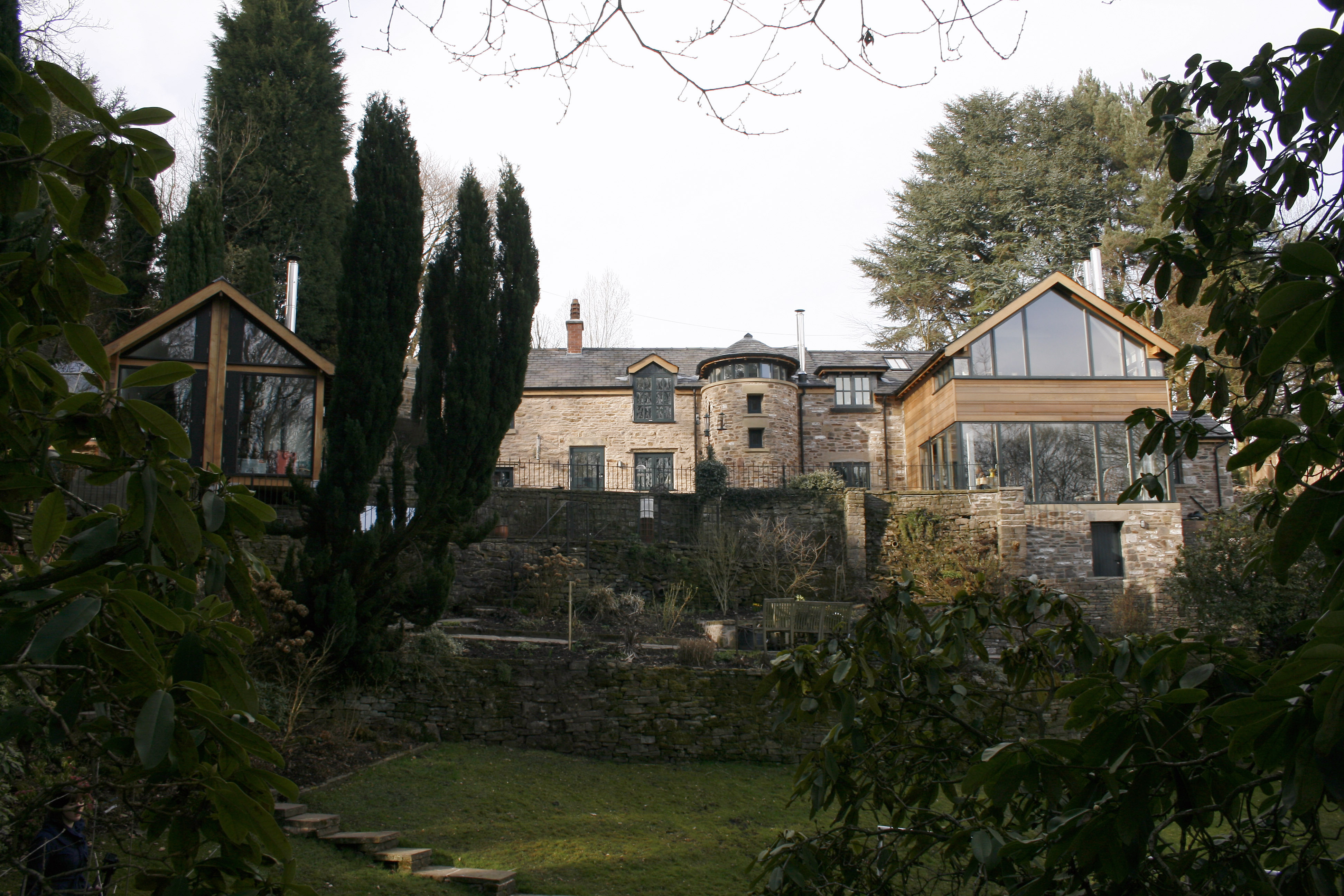 External showing stone house and timber clad extension