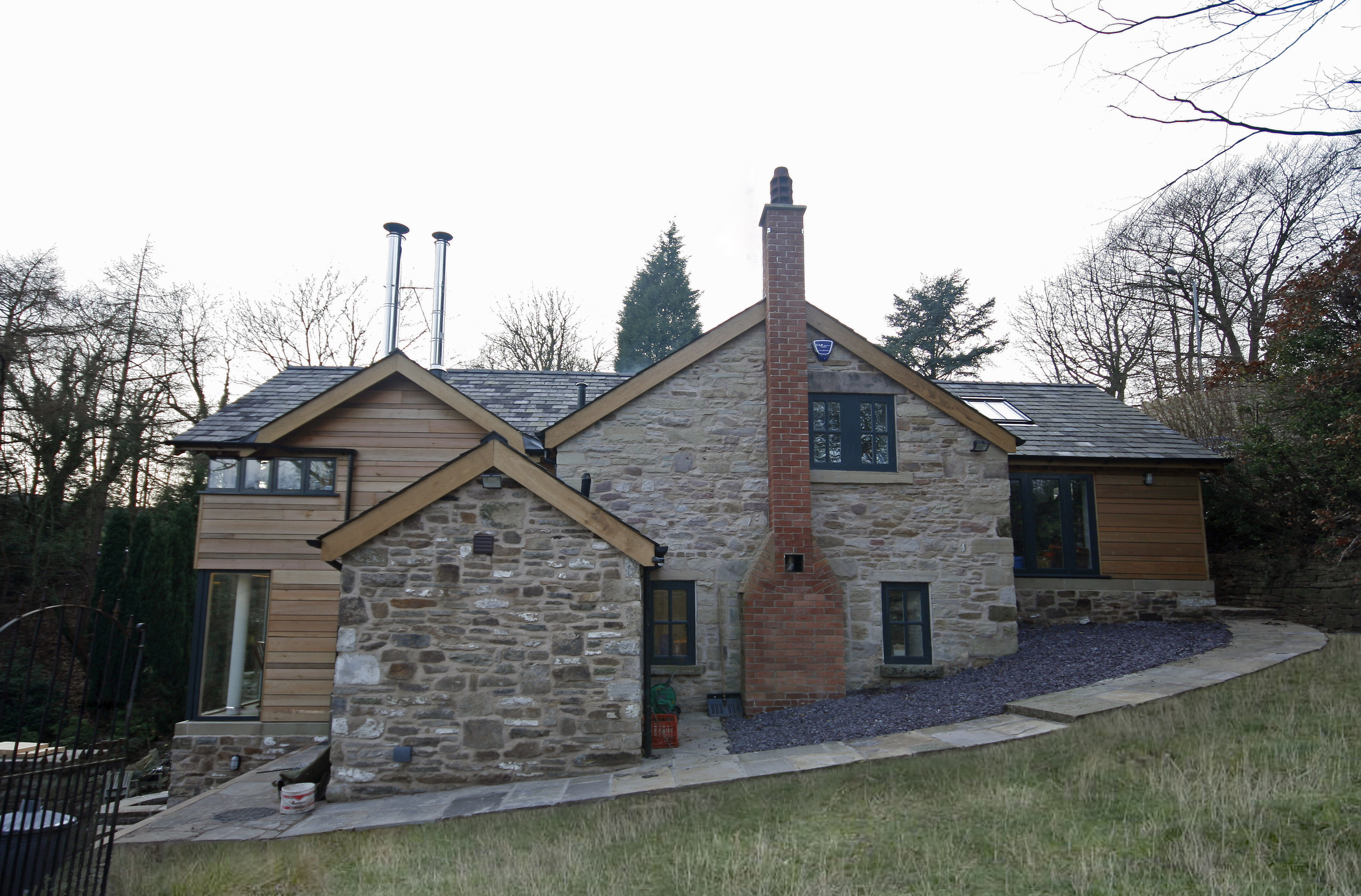 External stone house and timber extensions