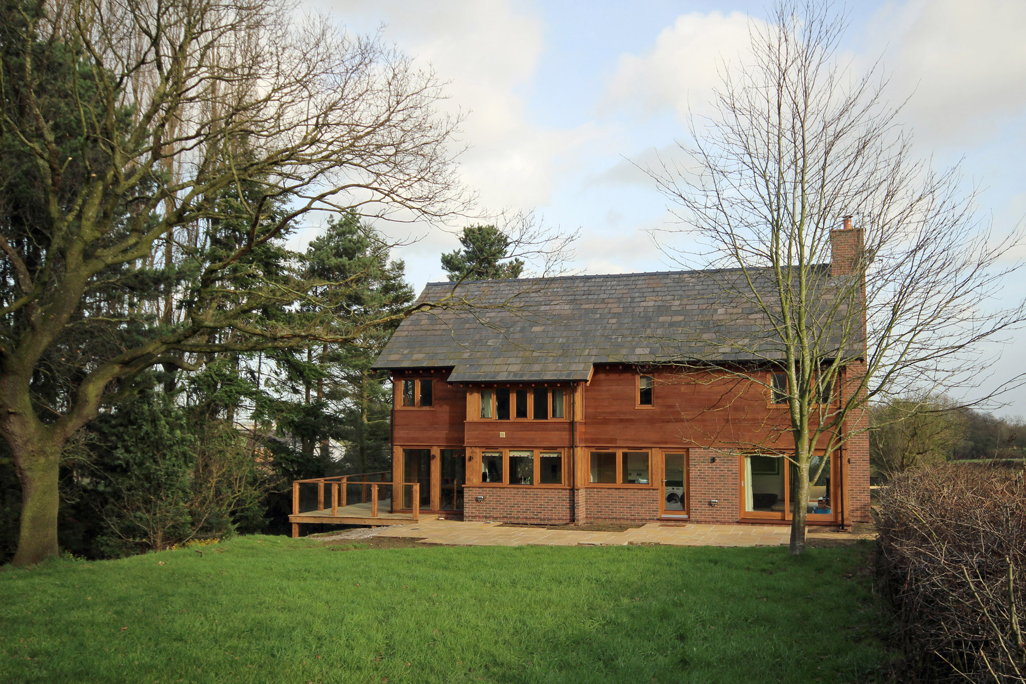Top Mill Cottage has brick and cedar cladding